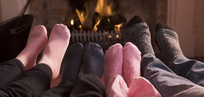 All Snug And Cozy, Warming Feet By The Fire
